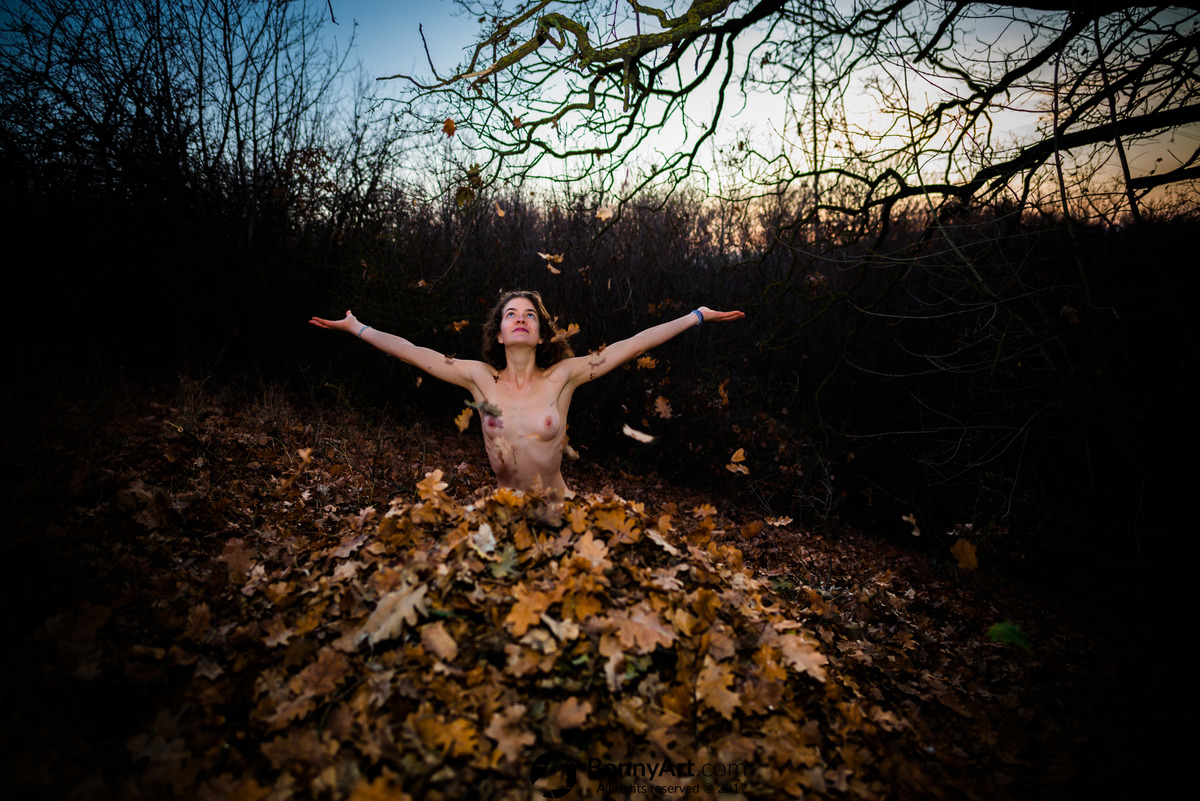 Nude Girl Buried in Autumn Leaves Playing