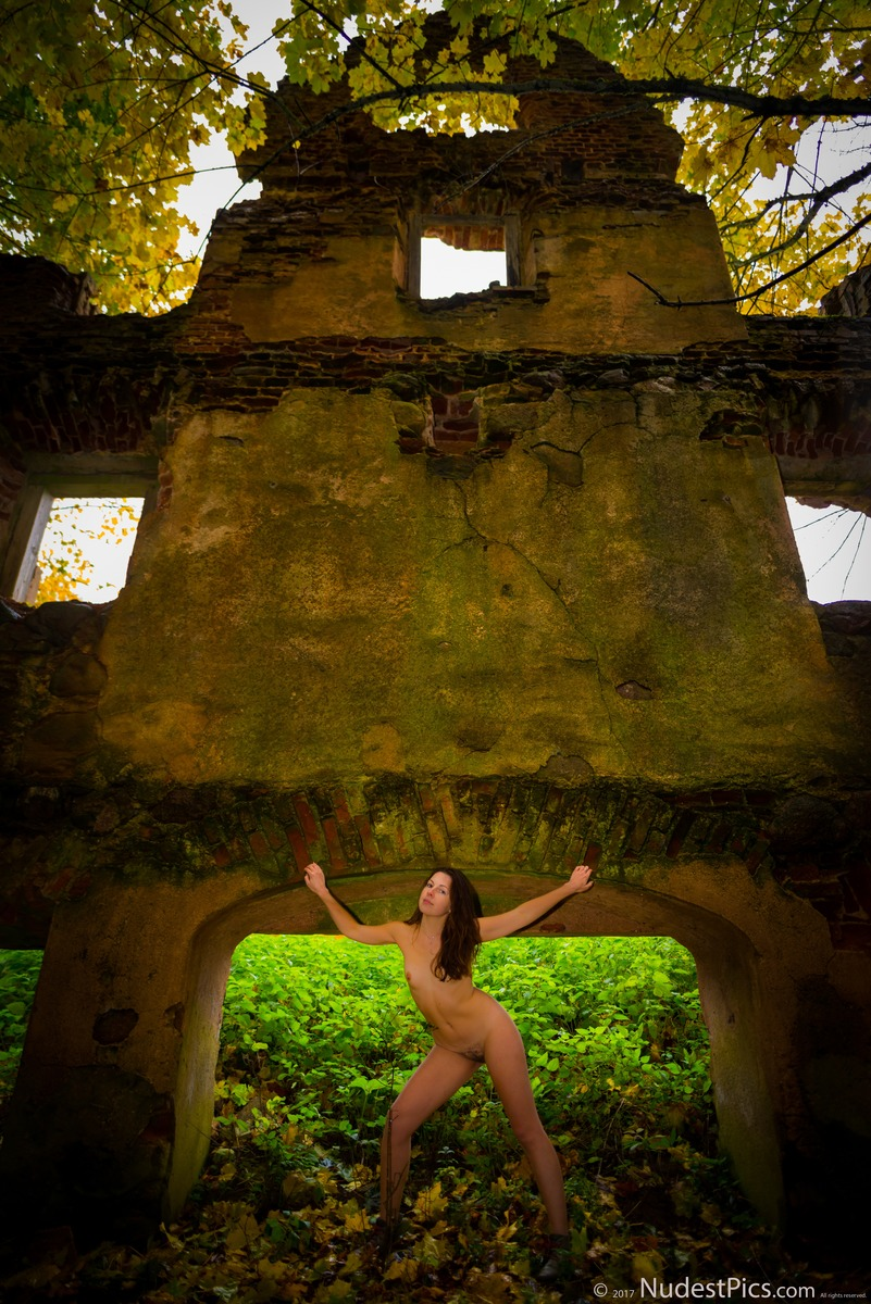Nude Girl Posing at the Ruined Wall