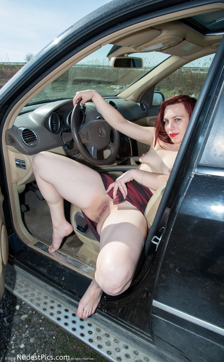 Topless Readhead Showing Pussy in Mercedes ML