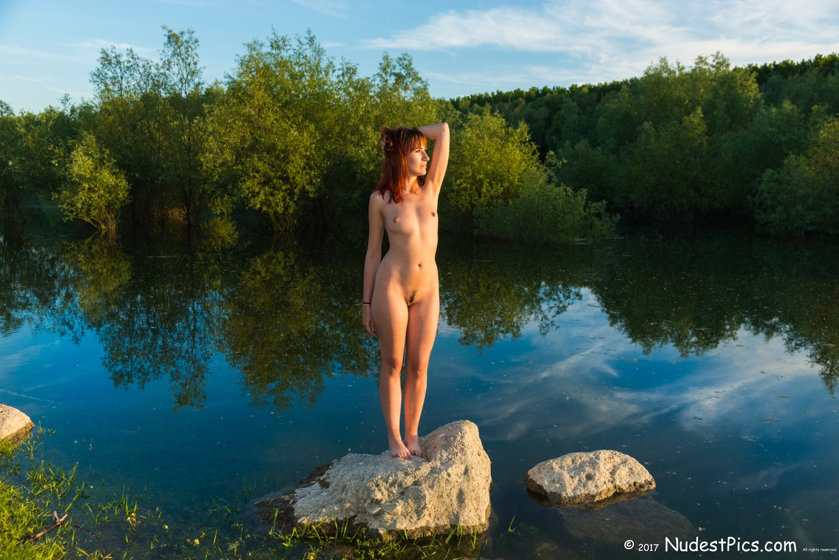 Nude Redhead at Sunset over the Colorful Pond