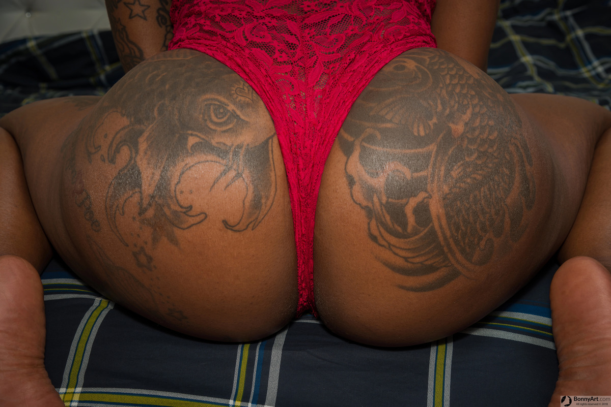 Huge Amazing Tattooed Brown Booty with Thong