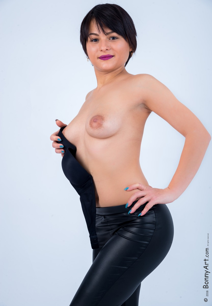 Brunette Undressing her White Breasts