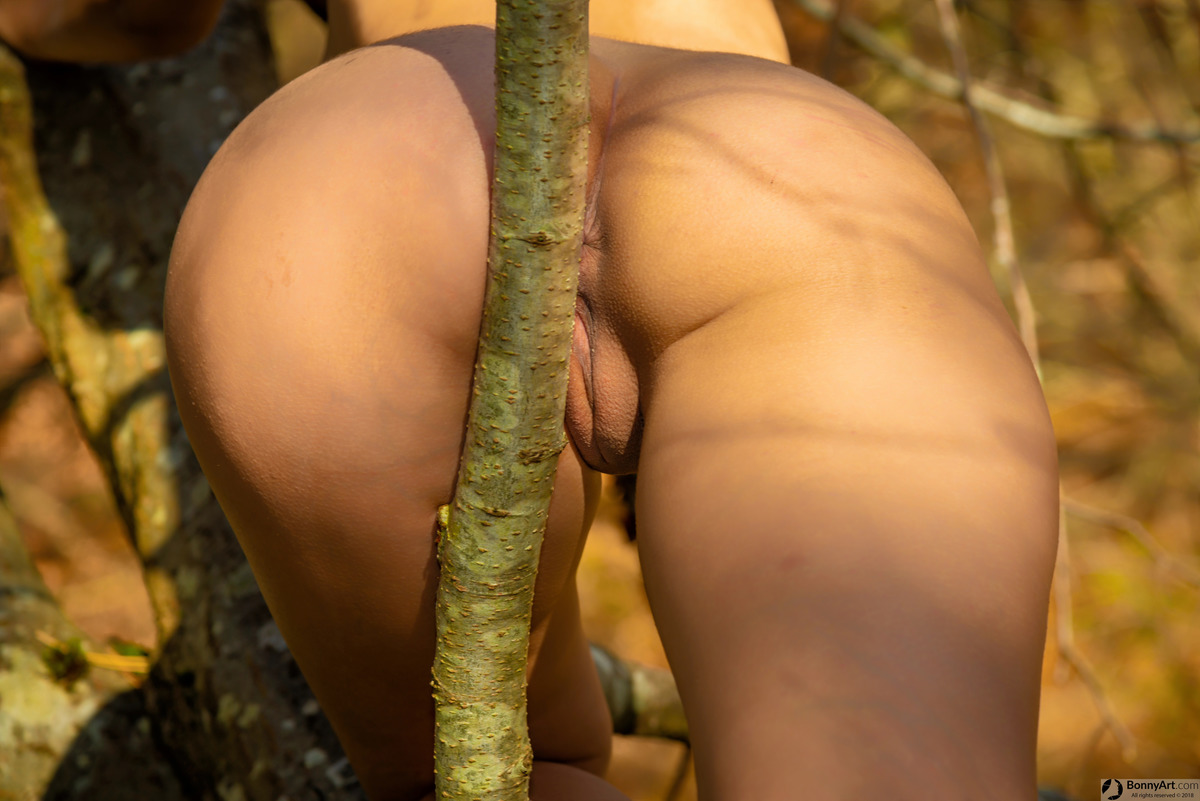 Spreading Naked Girl's Ass Against the Tree