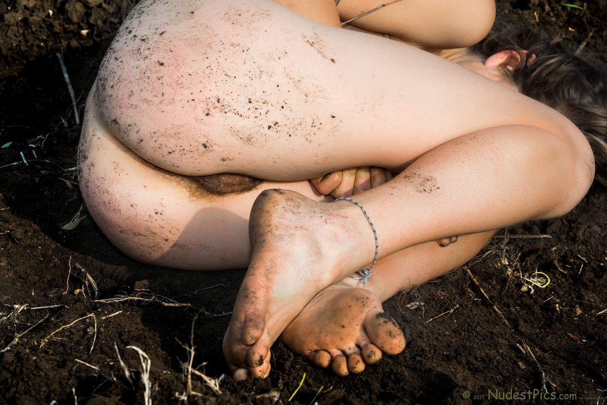 Natural Pubes Girl Squatting on the Soil