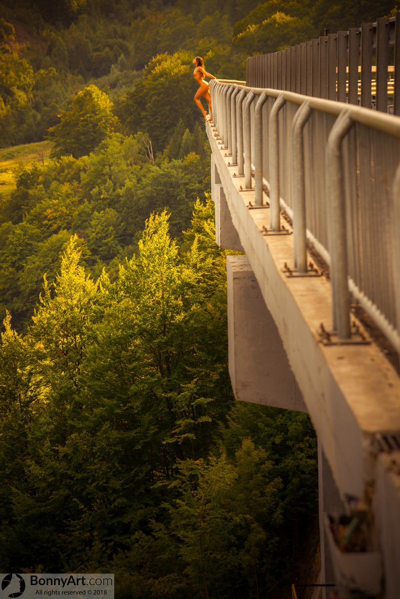 Beautiful Daredevil Girl on the Edge of the Bridge