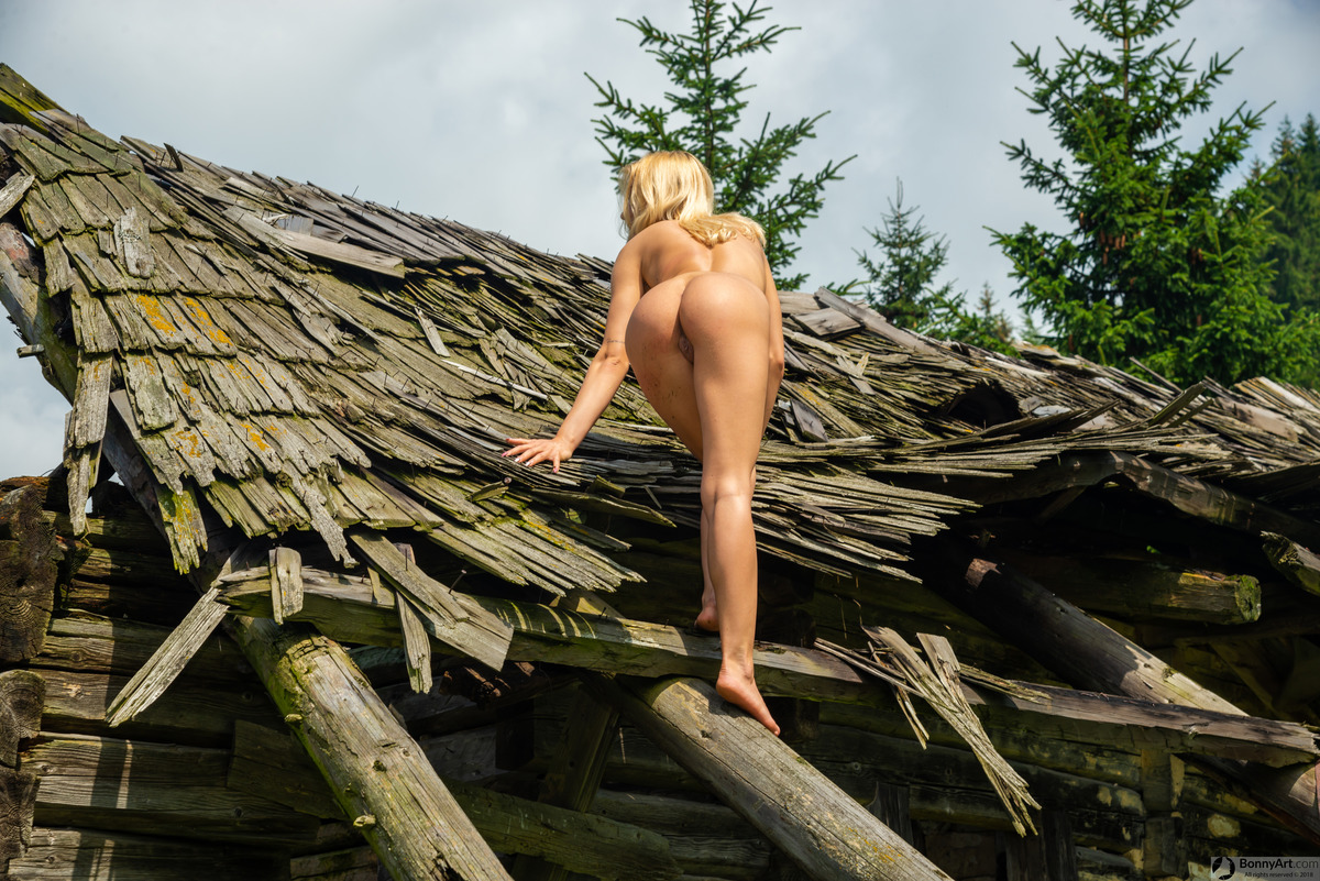 Blonde Nude Beauty Climbing Hut's Roof